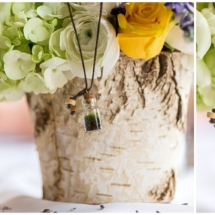 Terrarium neclkace. Missoula, Montana Destination Spring Wedding. Birch bark vase with white and yellow roses, hydrangea, mountain lupine