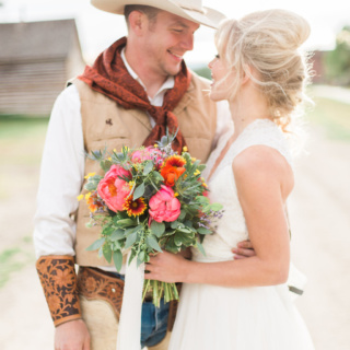 Styled shoot by Event by Autumn near Missoula, Montana. Lovely sunset themed bridal bouquet. Featuring coral peonies, eucalyptus, blanket flowers, statice and globe thistle. Bouquet tied with delicate white, long ribbon.