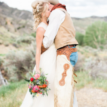 Lovely sunset themed bridal bouquet. Featuring coral peonies, eucalyptus, blanket flowers, statice and globe thistle. Bouquet tied with delicate white, long ribbon. Missoula Montana Flowers Events by Autumn Styled Shoot