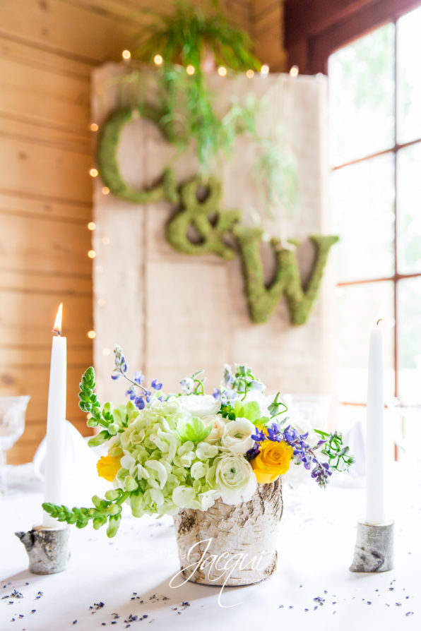 Moss decor. Missoula, Montana spring wedding flowers with birch bark vase and mountain lupine, roses and hydrangea