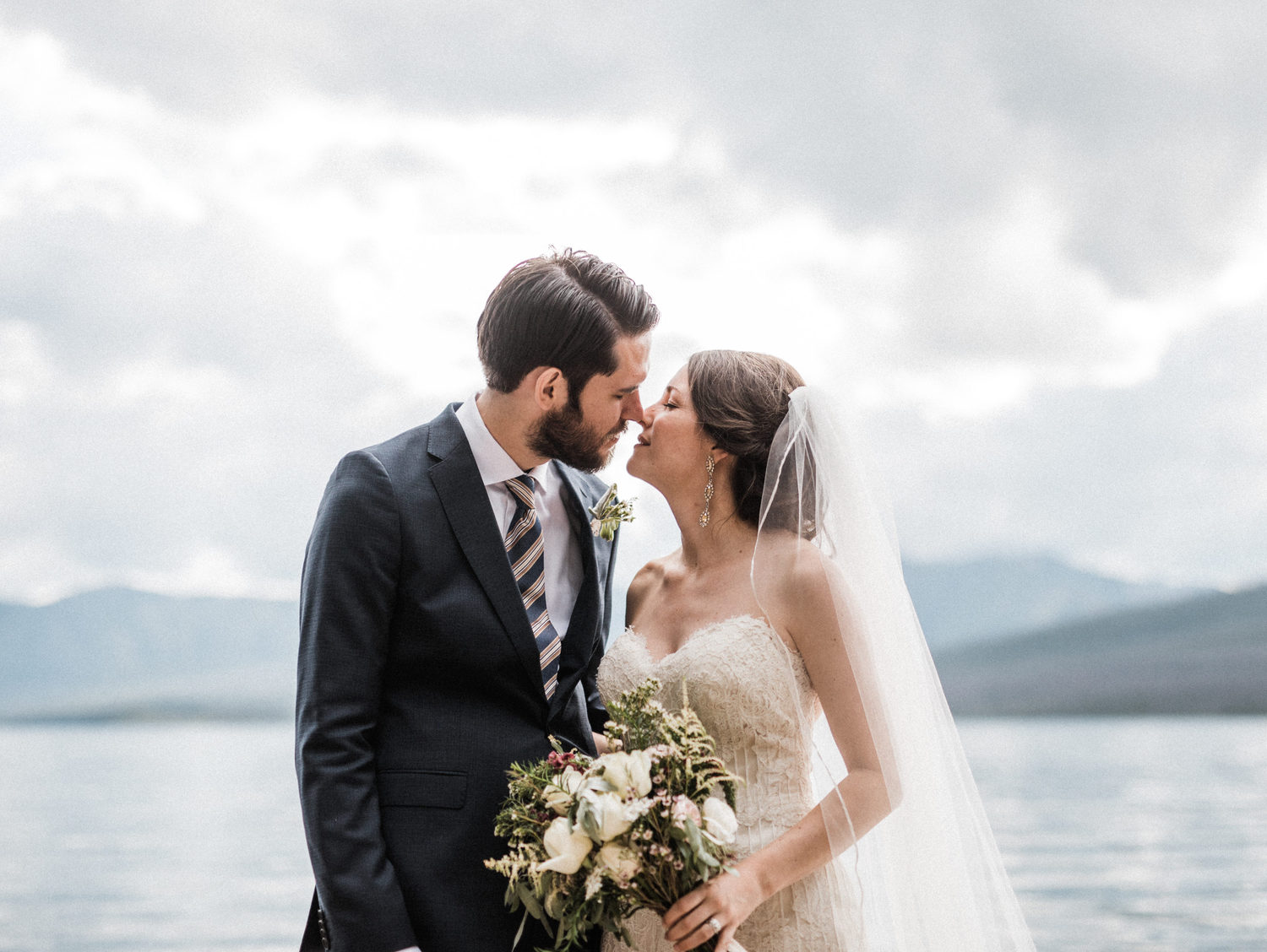Elegant Glacier National Park Wedding with wildflower bouquet