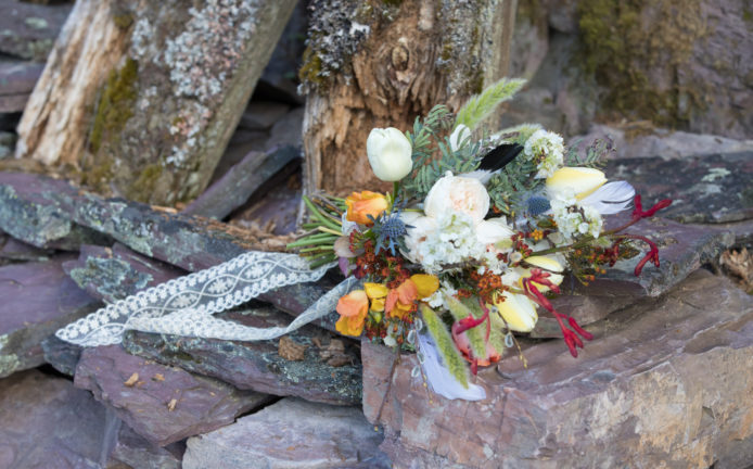 wildflower bouquet on rocks with lace