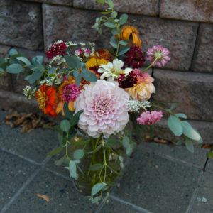 assorted flowers in vase that are seasonal to August