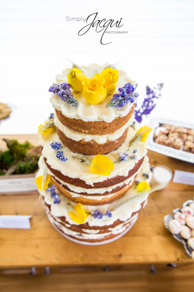 Montana Wedding Flowers. Wedding cake with lupine and yellow roses