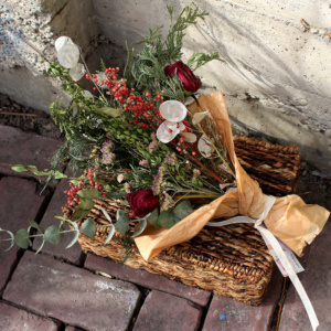 Red, white, and green dried flower bouquet