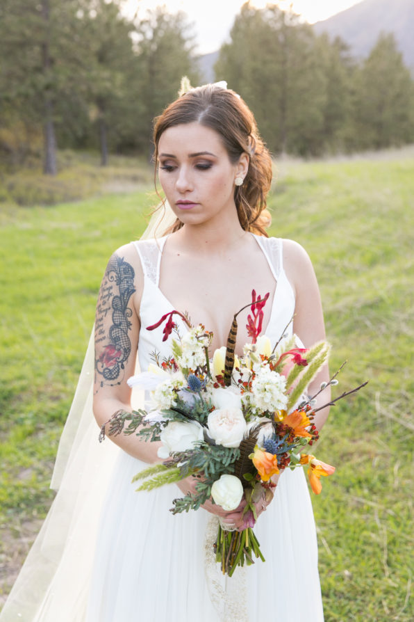 bright beautiful bouquet and tattooed bride for flight styled weeding