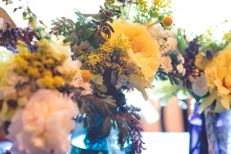 Sweet sunshine arrangement medium missoula natural floral design fresh flower arrangement with yellow and white peonies in a blue glass vase izmirmasajfo
