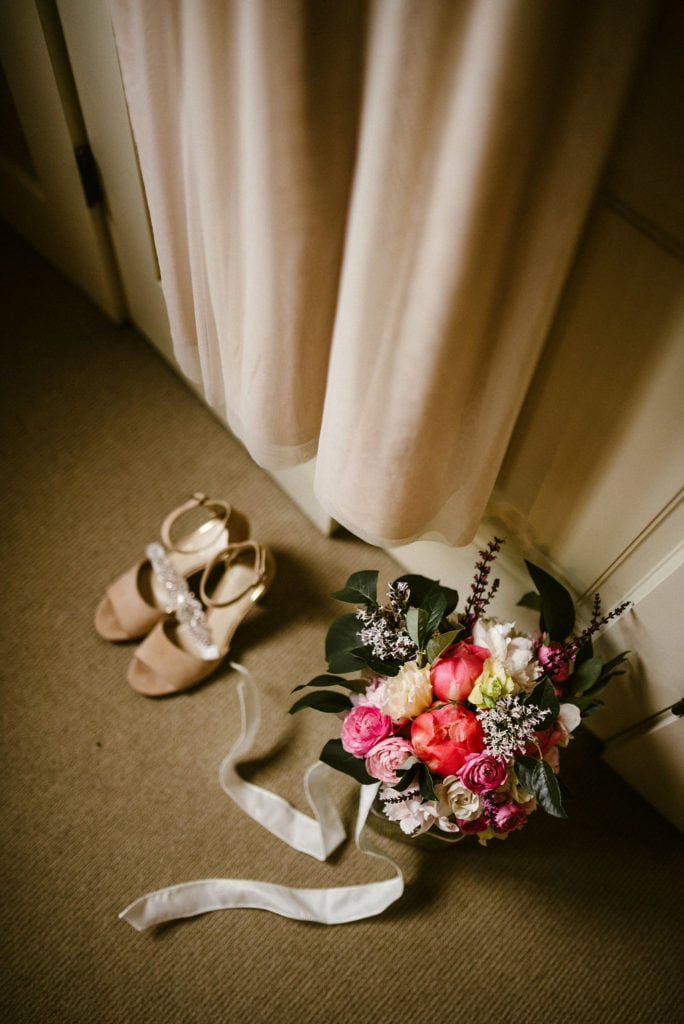 montana wedding flower bouquet next to wedding dress and shoes