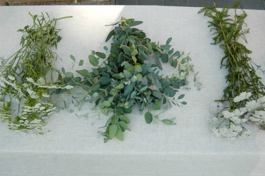 queen anne's lace, yarrow, and eucalyptus on a table