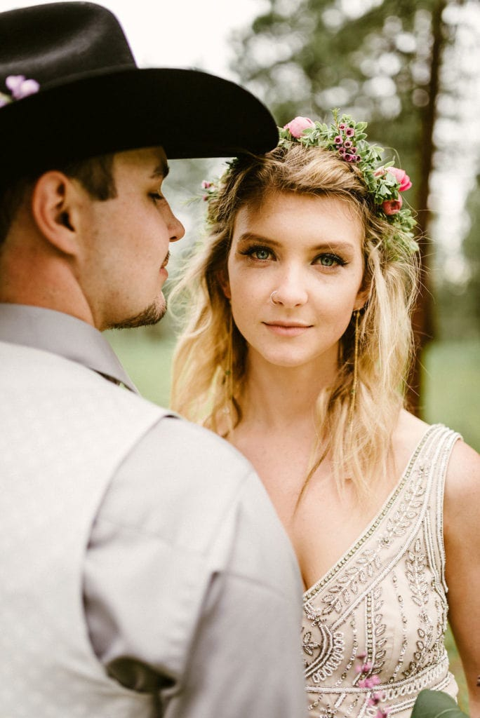 bride facing with crown with cowboy groom facing her