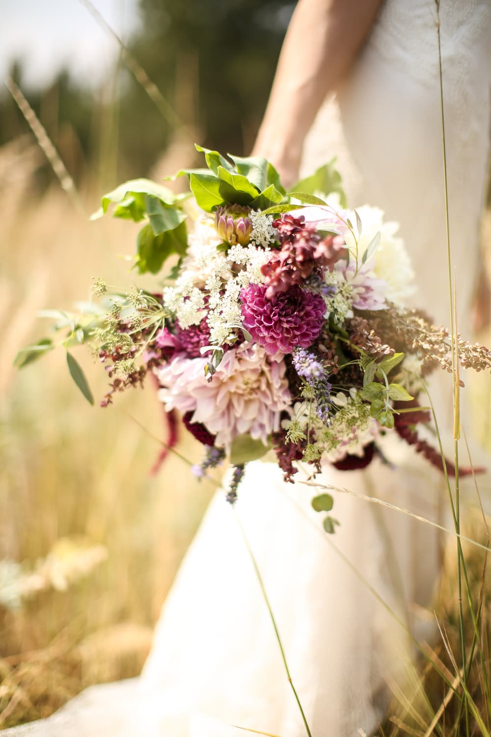 wildflower dahlia bridal bouquet with eggplant, magenta and blush hues
