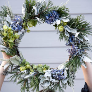 winter wreath made with hops, dusty miller and hydrangea in missoula, MT