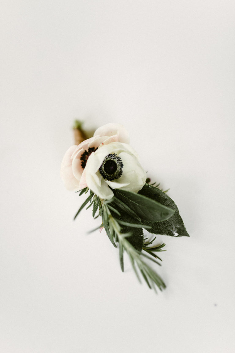 contact earth within flowers Groom boutonniere in Missoula, Montana Missoula Florist