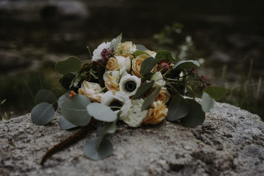 Bouquet by Montana Wedding Florist on a rock