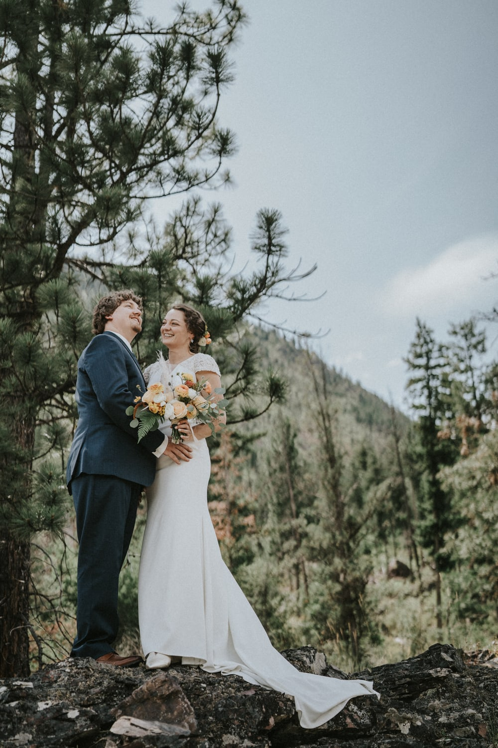 Bride and groom against mountain backdrop