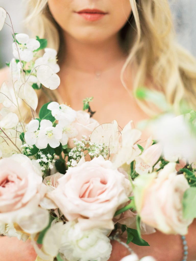 Hellebore, dried flowers, and roses in wedding bouquet
