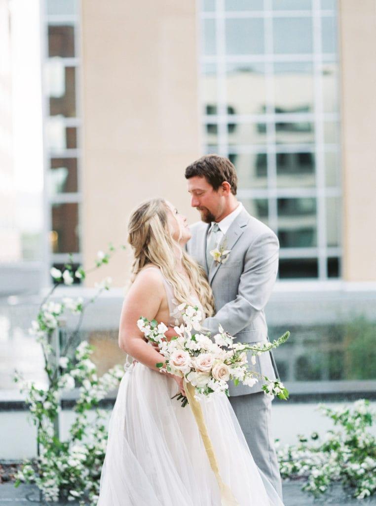 Bride and groom on Missoula rooftop
