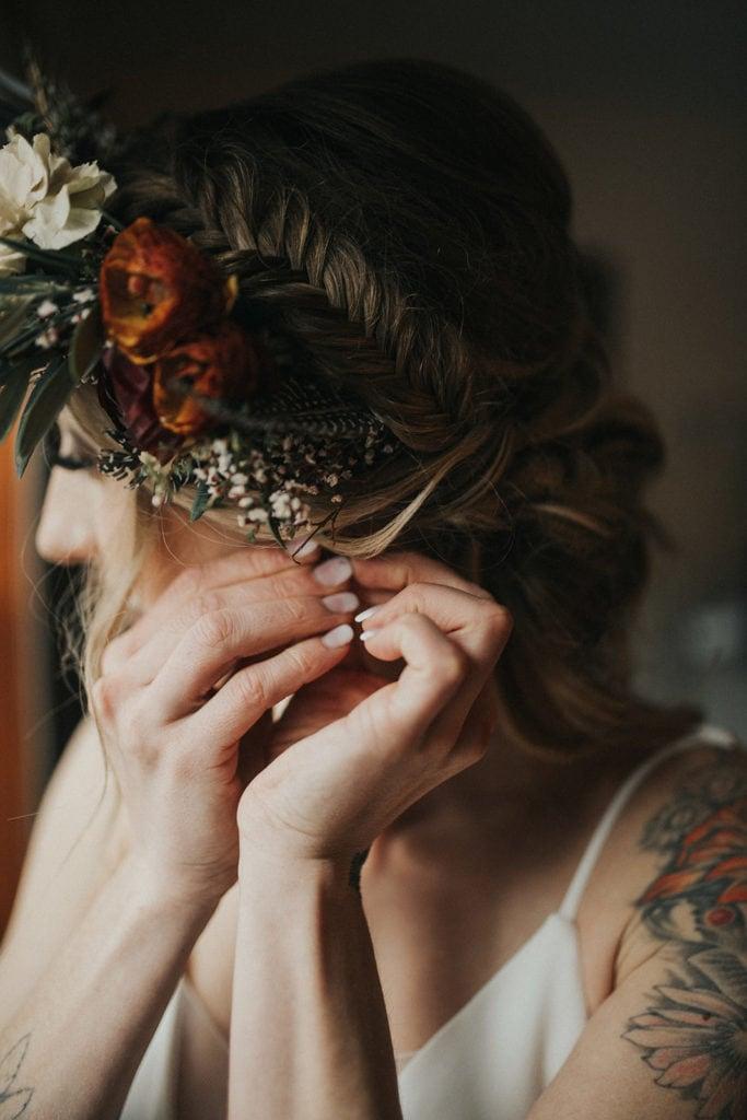 Bride adjusting flower crown