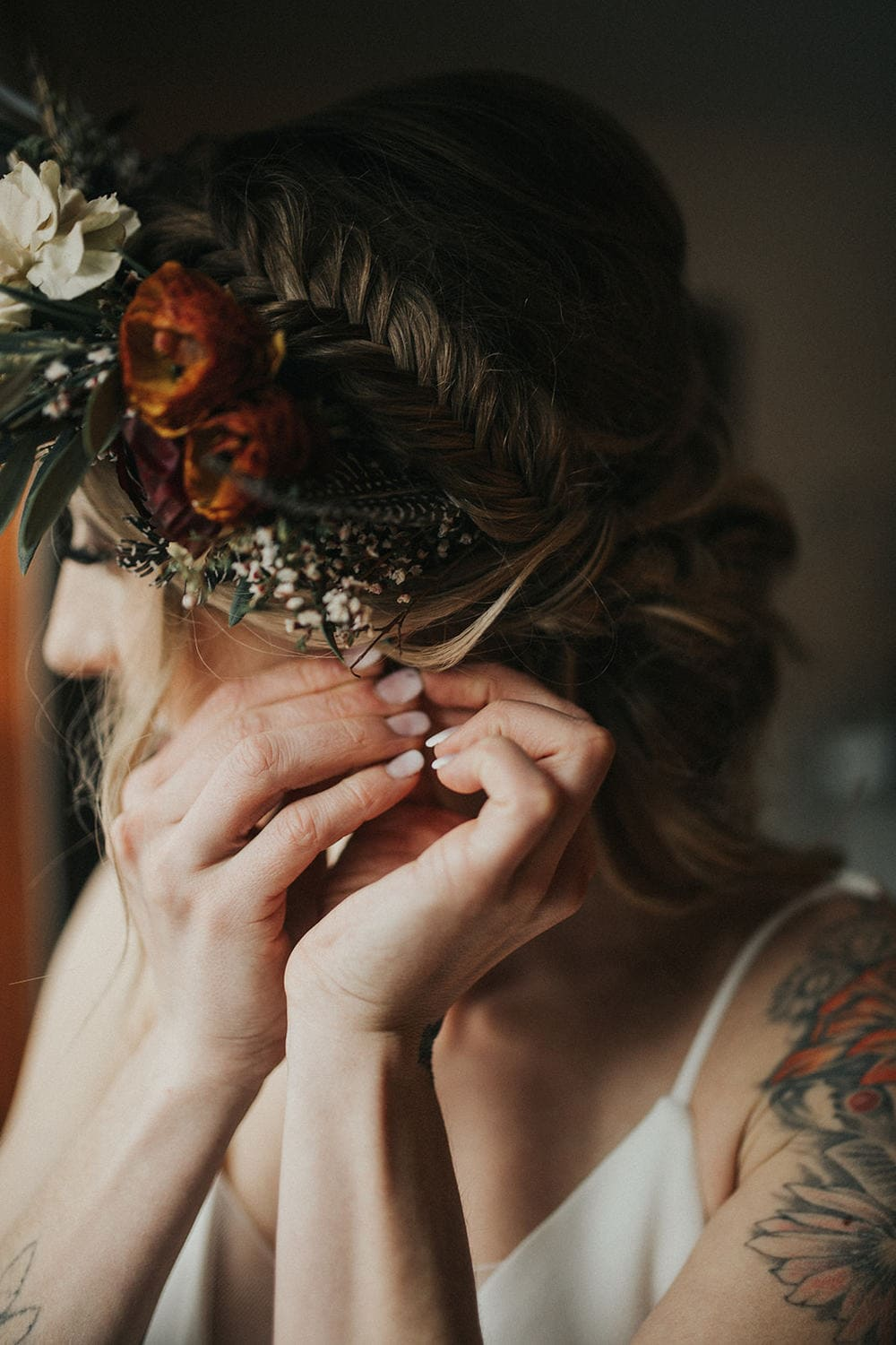 Bride adjusting flower crown