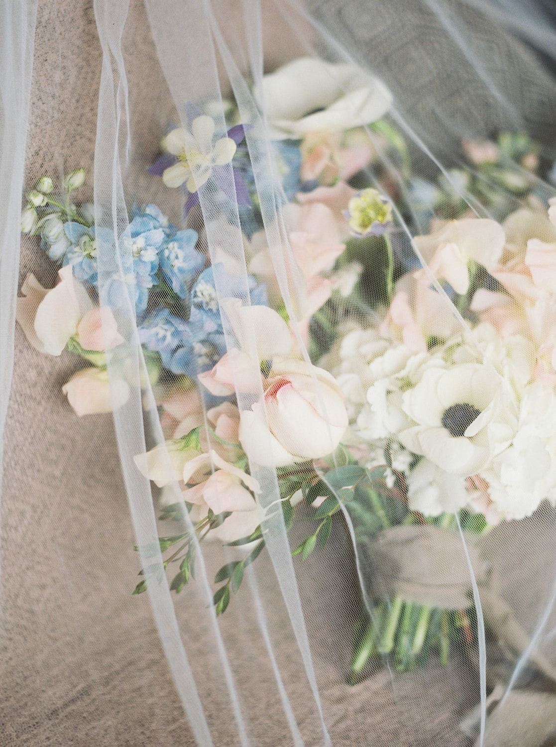 Bridal bouquet under the veil