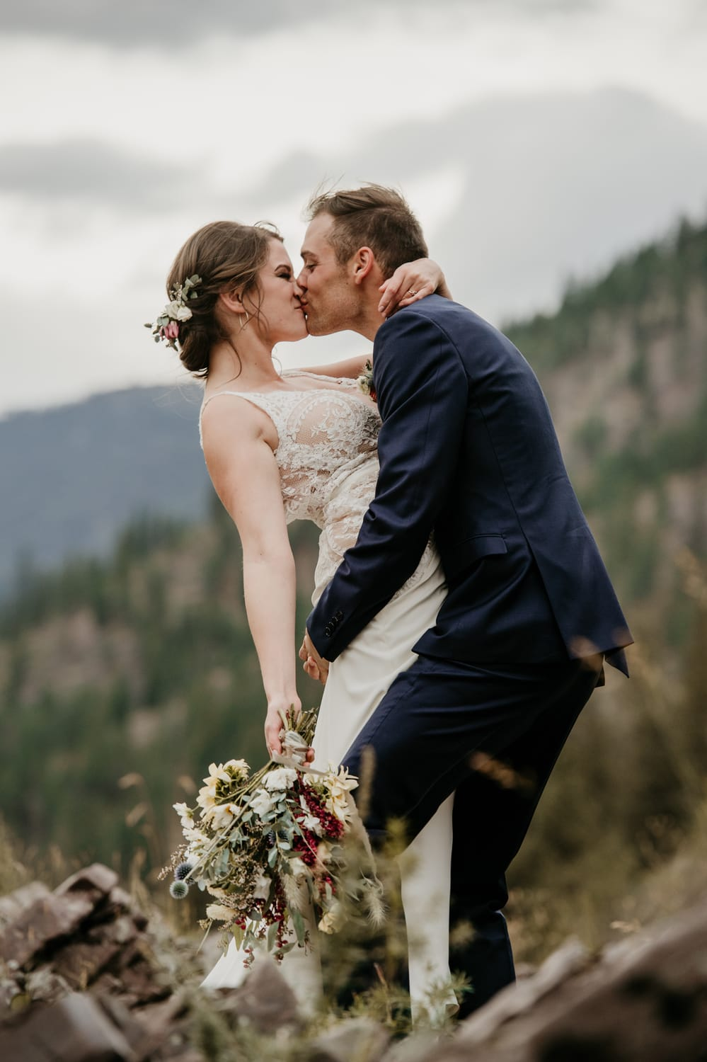 bride and groom kissing in montana