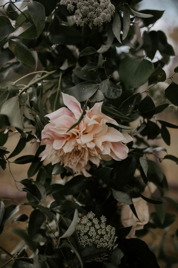 closeup of floral wedding arch