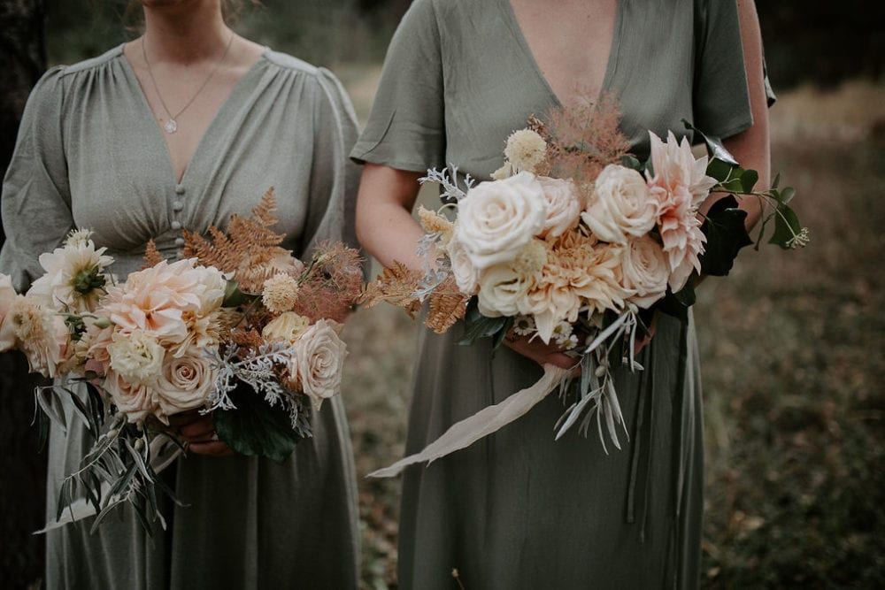 wedding flower consultation bridesmaid holding bouquets