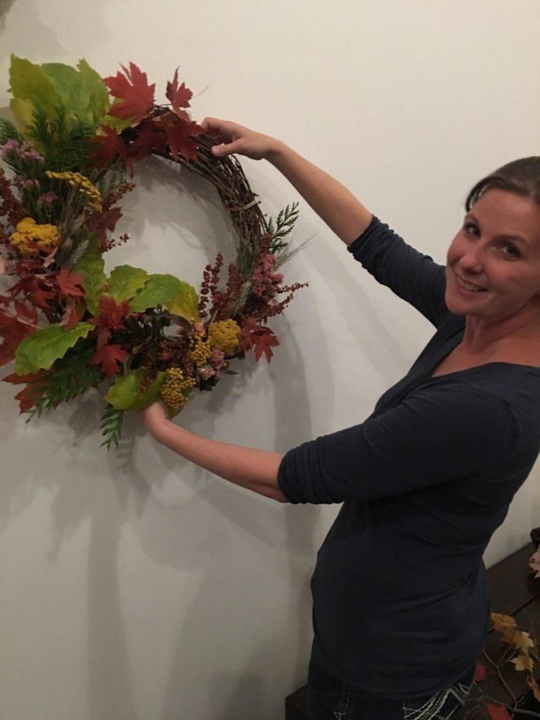 workshop attendee holding wreath