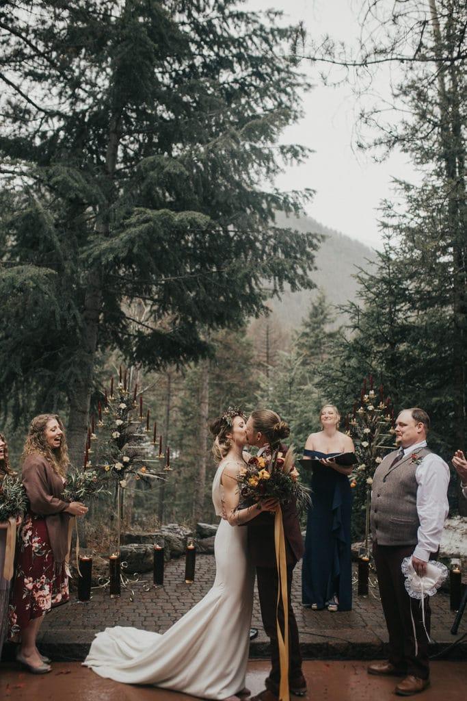 Bride and groom kiss during Montana wedding