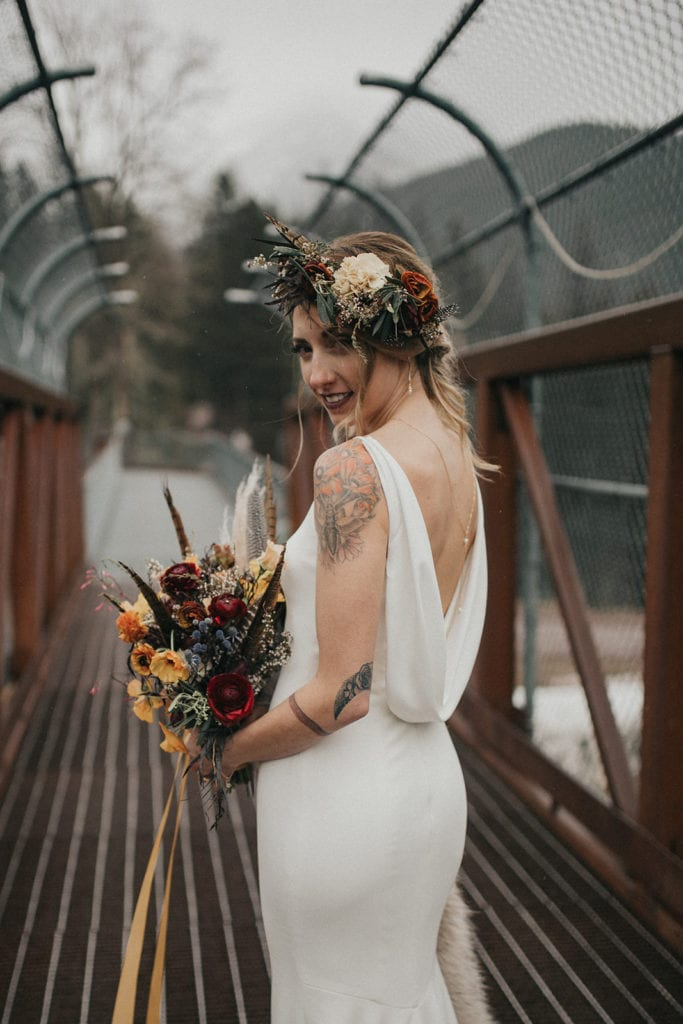 Bride holding bouquet and wearing flower crown designed by Missoula florist