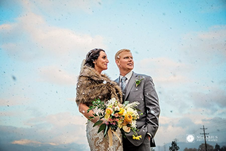 Bride and groom against texture sky